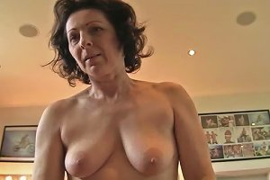 Mature Lady With Hanging Tits Sucks That Young Cock